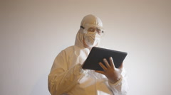 BIOHAZARD LAB TECHNICIAN with Ipad-tablet computer Stock Footage