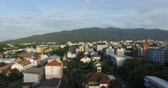 Aerial over Chiang Mai Nimmanhaemin towards mountains Stock Footage