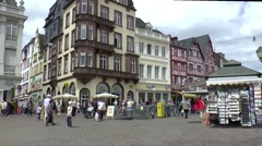 Many tourists are visiting the marketplace pittoresq city of Trier Stock Footage