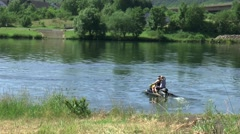 Watersporters use the jetsky on the River Moselle Stock Footage