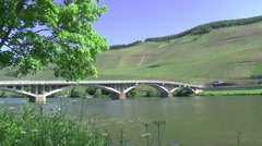 Pan over the River Moselle and the mosellebridge to the village of Piesport Stock Footage