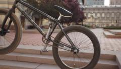 BMX trick crankflip stunt bike close up at sunset slow-mo Stock Footage