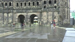 The Porta Nigra is one of the main reasons for tourists to visit Trier Stock Footage