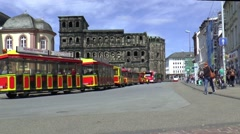 The Porta Nigra is one of the main reasons for tourists to visit Trier - stock footage