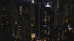 Lit up apartment blocks in downtown Hong Kong city 4K Stock Footage
