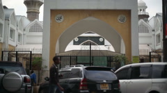 Jamia mosque entrance, tilt up crescent on roof, Nairobi city center, Africa Stock Footage