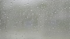 Water drops on car glass while car moving, rain continued outside Stock Footage