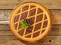 Lattice topped chocolate tart - overhead - stock photo