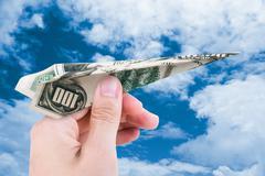 Dollar Plane Stock Photos