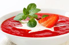 Bowl of chilled strawberry soup with cream Stock Photos