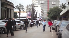 Women walk down a busy street in Nairobi city center, Kenya, Africa - stock footage