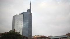 Skyscraper buildings Nairobi city center, tilt down Kenyatta Avenue, Africa Stock Footage