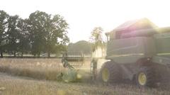 Combine Working in Dusty Field Stock Footage