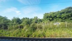 4K UltraHd Restful countryside view from a train Stock Footage