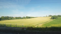 4K UltraHd Sunny countryside view from a train Stock Footage
