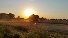 Harvester Working in Field 3 Stock Footage