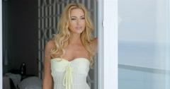 Sexy Woman Standing Beside Patio Glass Doors Stock Footage
