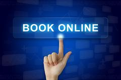 Hand press on book online button on touch screen Stock Photos