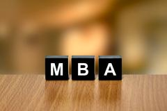 MBA or Master of Business Administration on black block - stock photo