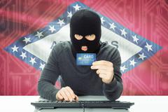 Hacker with US state flag on background - Arkansas Stock Photos