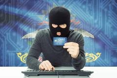 Hacker with US state flag on background - North Dakota - stock photo