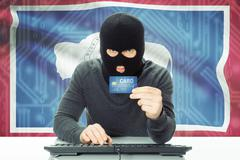 Stock Photo of Hacker with US state flag on background - Wyoming