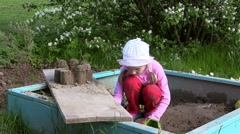 Girl playing in the sandbox - stock footage