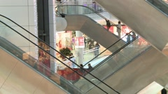 People in the mall move on escalators  , Vologda , Russia , cranking Stock Footage