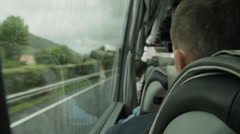 Passenger traveling by coach bus looking out of window Stock Footage
