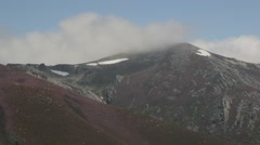 Country landscape mountains covered in heather and snow. Clouds moving - stock footage