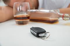 Stock Photo of Close-up Of Drunk Man With Glass Of Liquor And Car Key