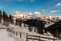 Wind and cold on a road in a winter evening in the italian dolomiti Stock Photos