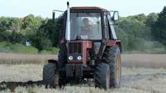 А tractor plowing a field Stock Footage