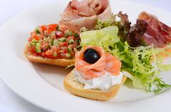 The bruschetta with various toppings - stock photo