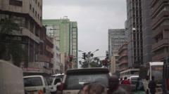 Driving through busy street, police directing, Nairobi, Kenya, Africa - stock footage