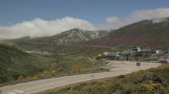 Mountain landscape with ski resort in background with snow and clouds Stock Footage