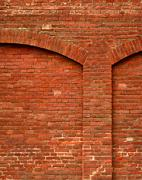 Stock Photo of red brick wall with arch