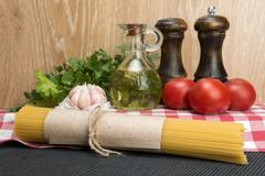 Spaghetti and ingredients for seasoning Stock Photos