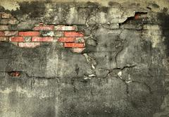 wall with fallen off plaster - stock photo