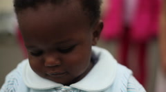 Cute African baby chewing on tupperware, Kenya, Africa - stock footage