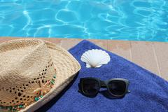 Poolside holiday vacation scenic swimming pool summer Stock Photos