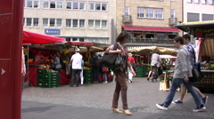 Timelapse of busy shoppers and market stalls in Germany Stock Footage