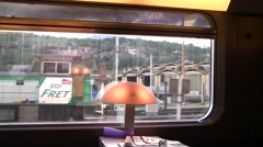 Pulling into a train station, from inside train Stock Footage