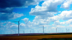 Wind Turbines With Turquoise Sky, Green Energy. Time Lapse, Zoom Out - stock footage
