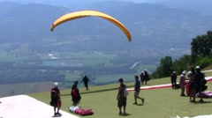 Paragliders set up, prepare and launch, France Stock Footage