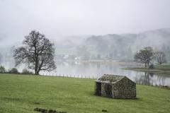 Stock Photo of Landscape on misty morning of fields around Lake Windermere in Lake District