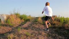 Escape boy in nature Stock Footage