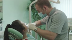 The dentist treats tooth - stock footage