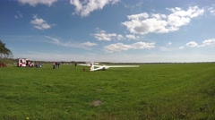 Aircraft sailplane glider taking off grass airfield being pushed by young man 4k Stock Footage