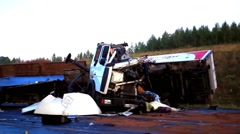 The truck lies in a ditch after the road accident Stock Footage